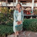 Shopbop sale maternity favorites featured by top US fashion blog, Glass of Glam: image of a woman wearing an Ingrid & Isabel dress, Splendid flat sandals, Old Navy denim jacket, and BAUBLEBAR statement earrings
