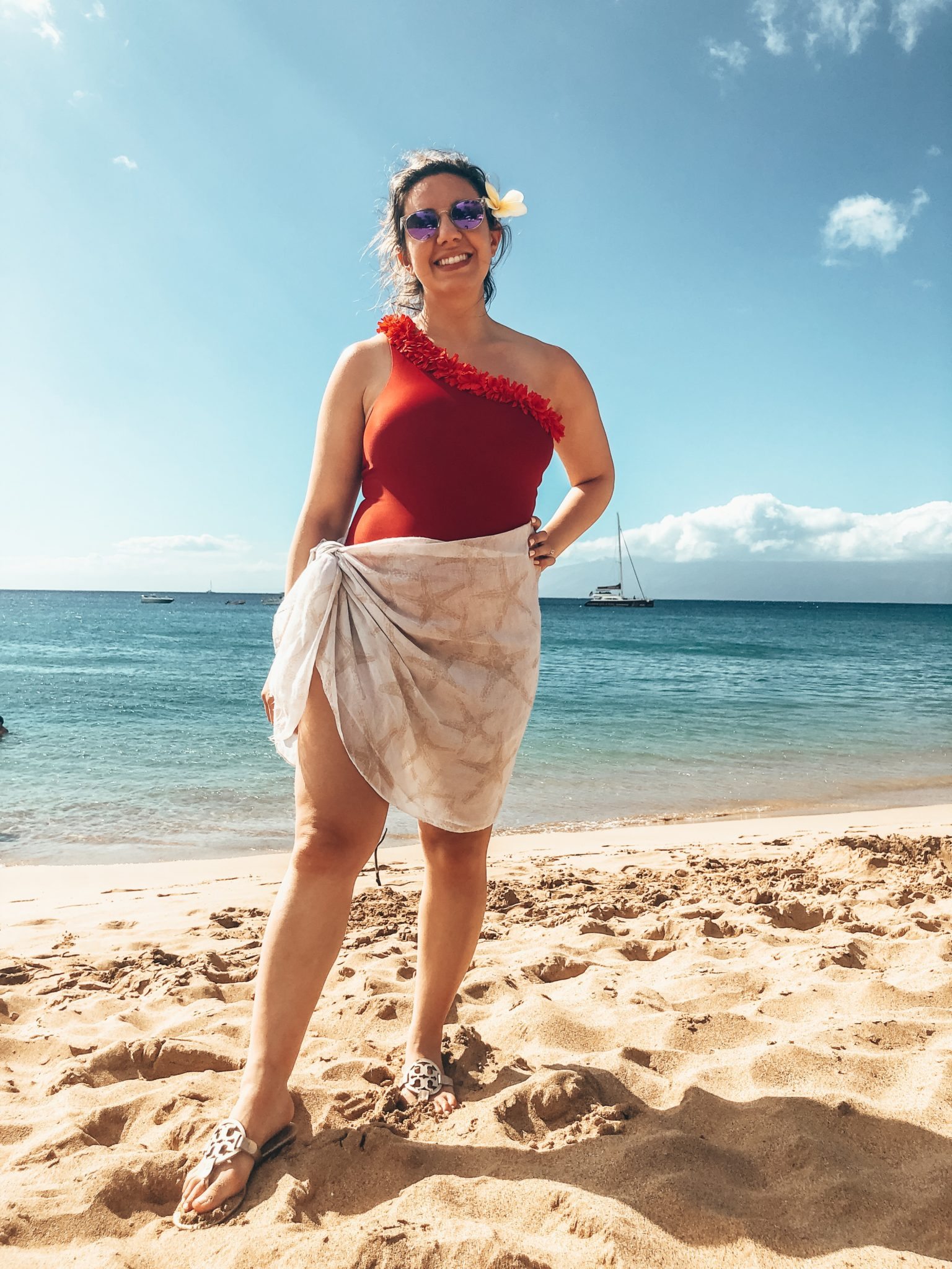 Maui Packing List and outfit round up featured by top US fashion blog, Glass of Glam: image of a woman wearing a Summersalt red swimsuit