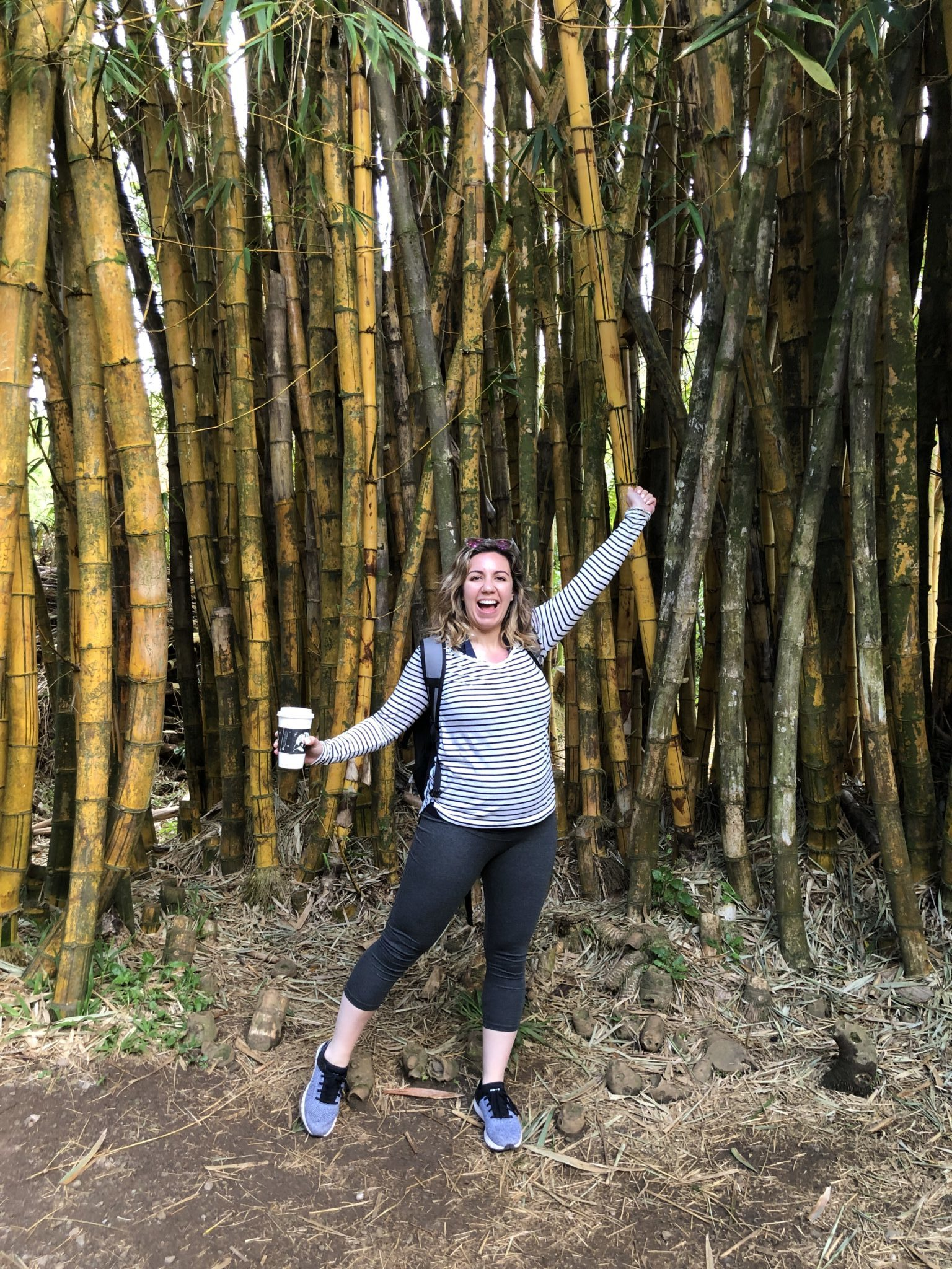 Maui Packing List and outfit round up featured by top US fashion blog, Glass of Glam: image of a woman wearing a BP striped tee, Amazon Leggings and Under Armour sneakers