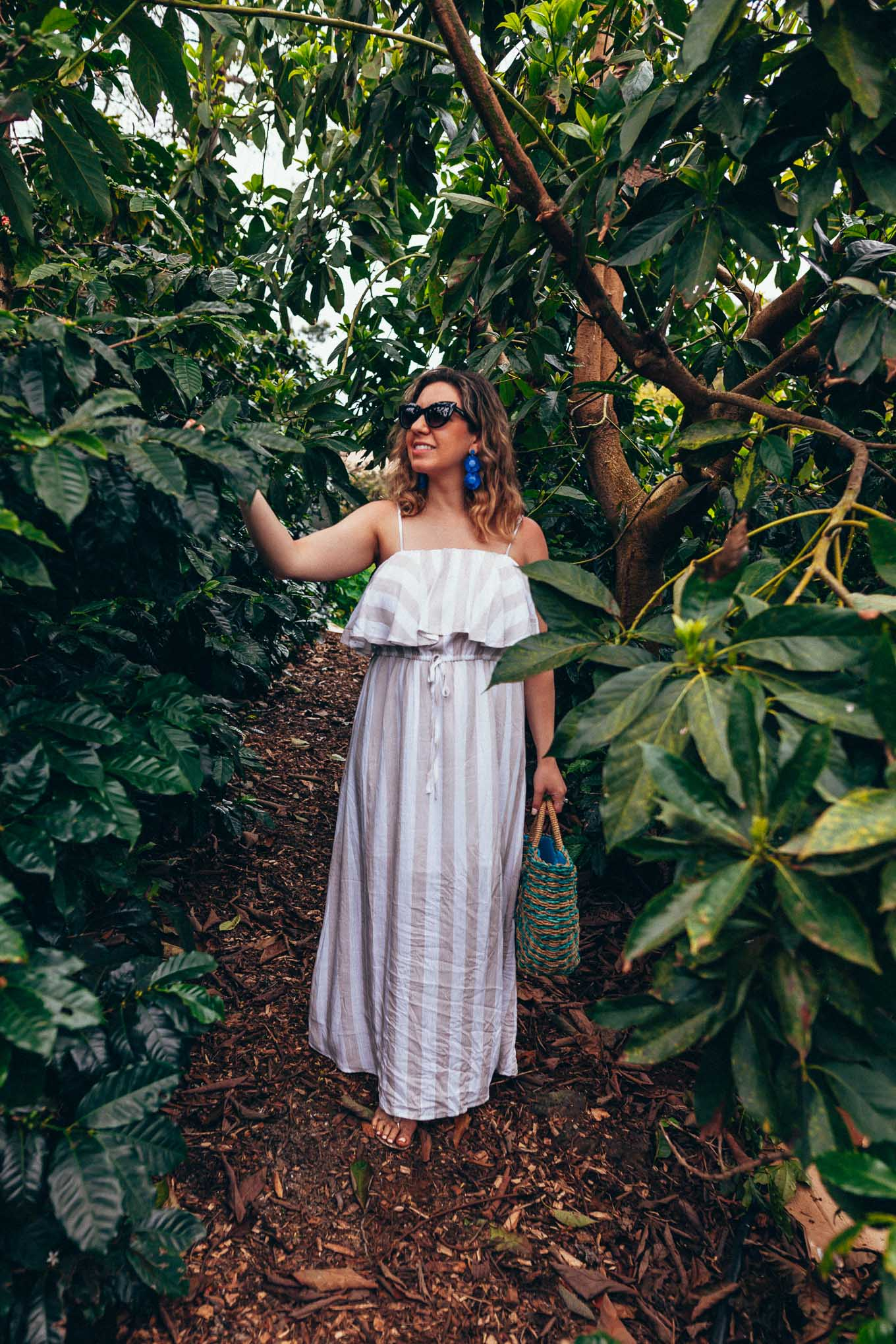 Maui Packing List and outfit round up featured by top US fashion blog, Glass of Glam: image of a woman wearing a Forever 21 striped maxi dress