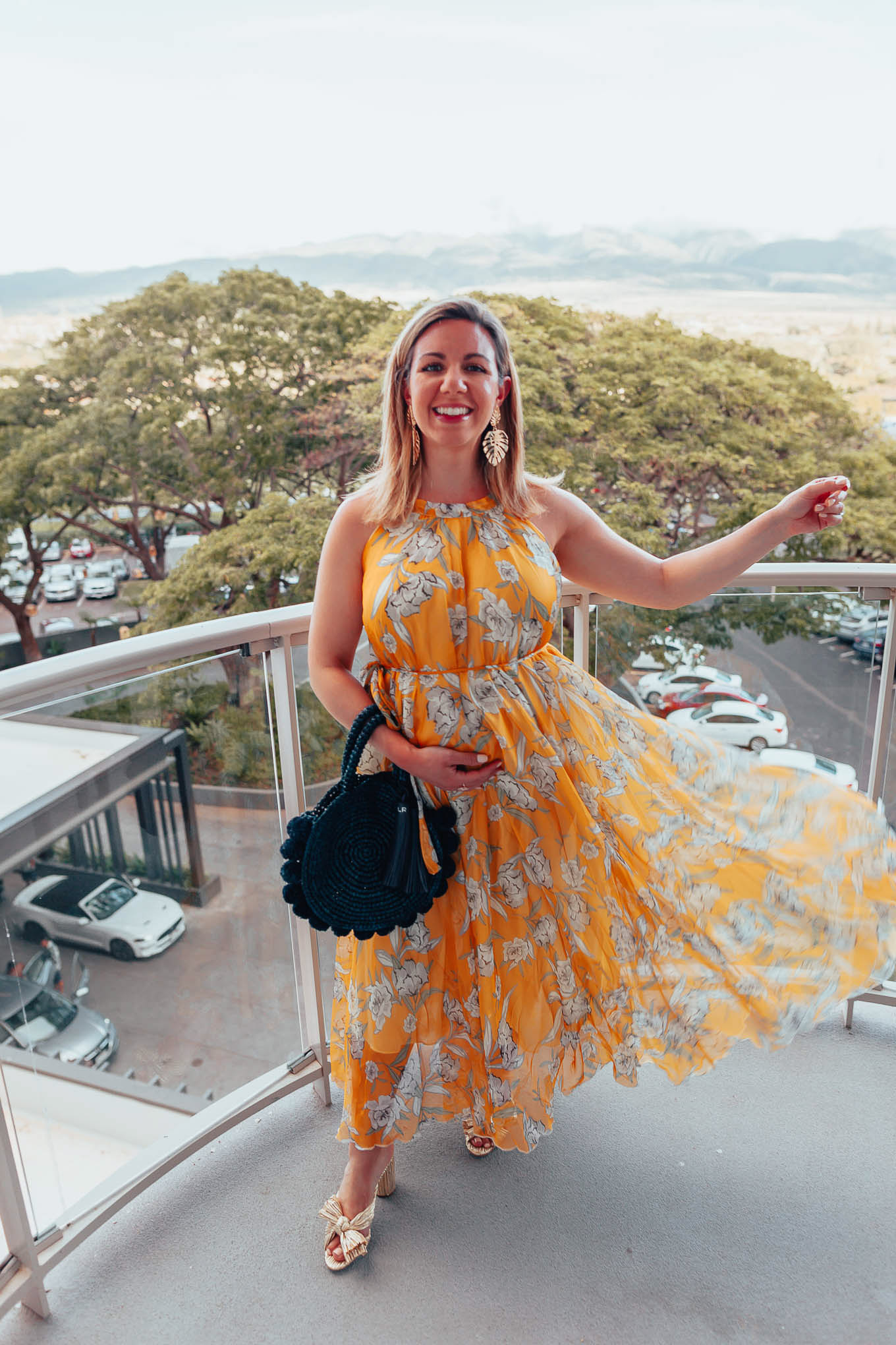 Maui Packing List and outfit round up featured by top US fashion blog, Glass of Glam: image of a woman wearing a Chicwish floral yellow dress