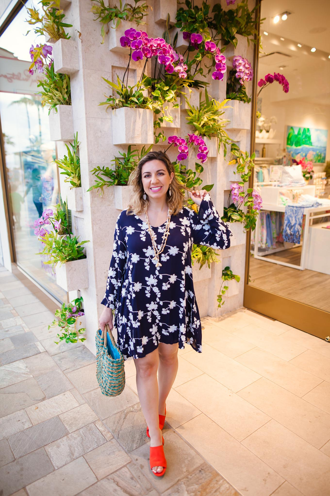 Maui Packing List and outfit round up featured by top US fashion blog, Glass of Glam: image of a woman wearing an Altar'd State floral dress