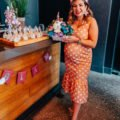 Baby Shower outfit featured by top US fashion blog, Glass of Glam: image of a pregnant woman attending her baby shower wearing an ASOS polka dot maternity dress, Loeffler Randall sandals, and Big Flower statement earrings.