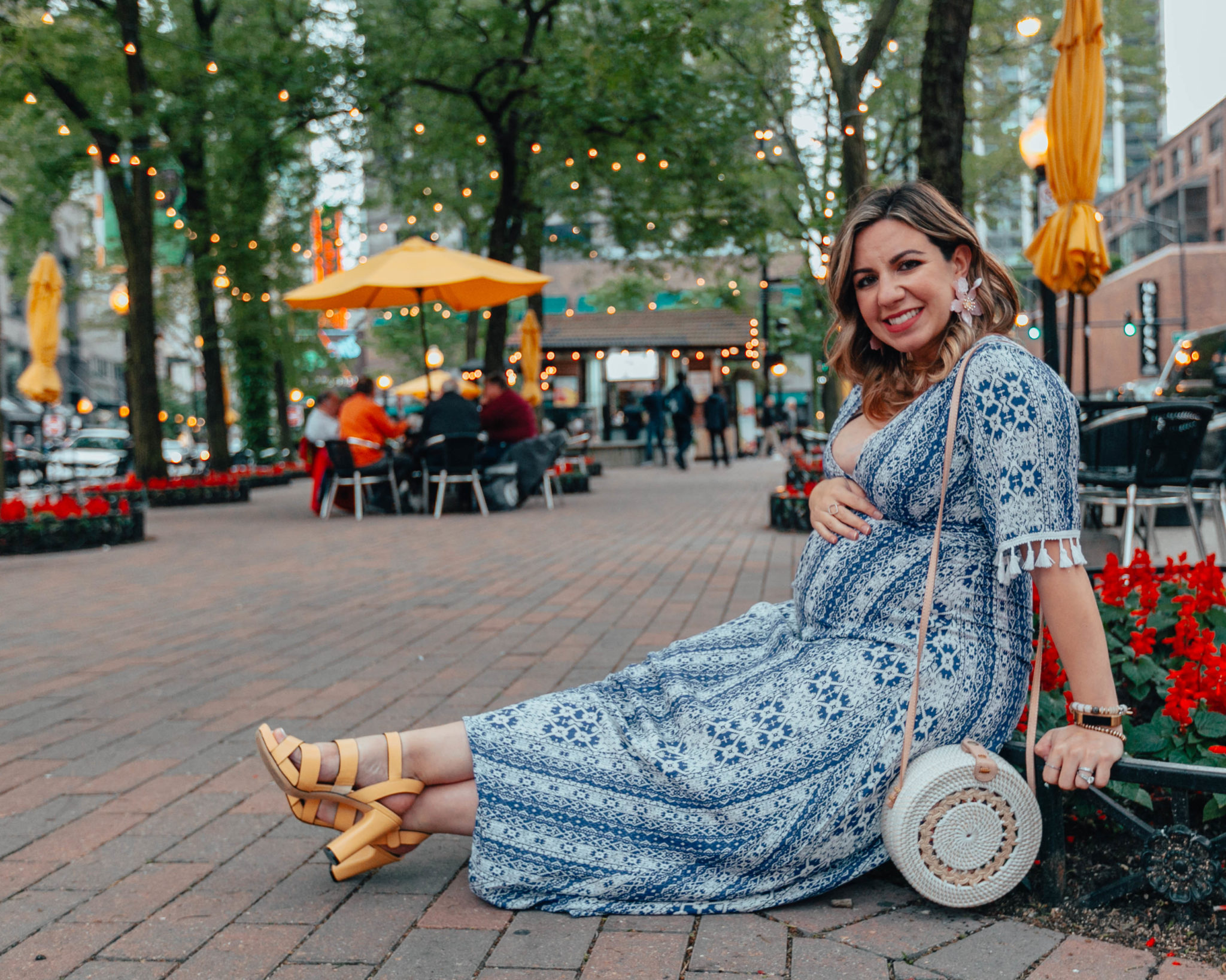 Naturalizer sandals on sale featured by top US fashion blog, Glass of Glam: image of a pregnant woman wearing a SheIn tassel maxi dress, big flower statement earrings, and Naturalizer yellow heel sandals