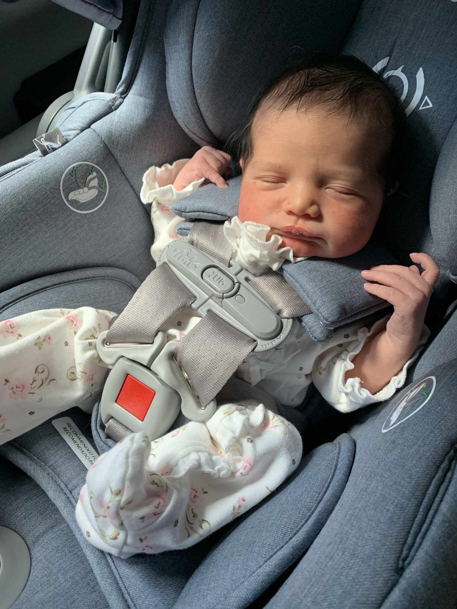 Baby Girl Birth Story: Welcome Sidney Eileen! by popular life and style blog, Glass of Glam: image of a newborn baby girl in a carseat.