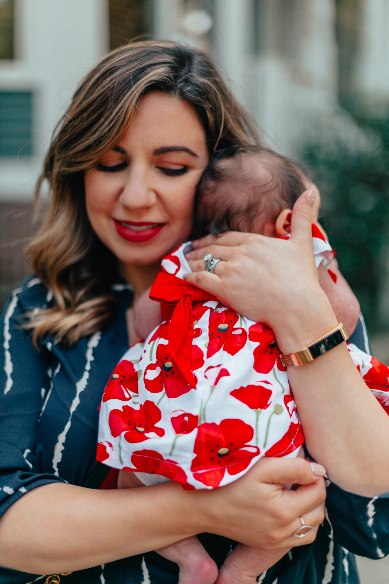 Designing My Push Present: Ivy and Rose Jewelry by popular Chicago fashion blog, Glass of Glam: image of a woman holding her baby and wearing a custom ring from Ivy and Rose Jewelry and a All in Favor Print Wrap Front Gathered Hem Top.