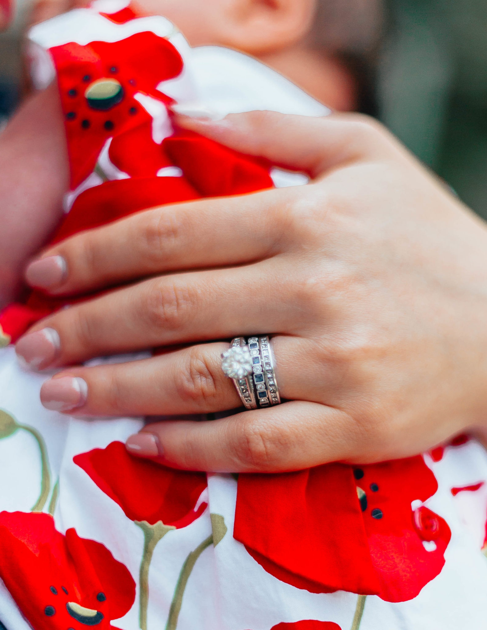 Designing My Push Present: Ivy and Rose Jewelry by popular Chicago fashion blog, Glass of Glam: image of a woman holding her baby and wearing a custom ring from Ivy and Rose Jewelry.
