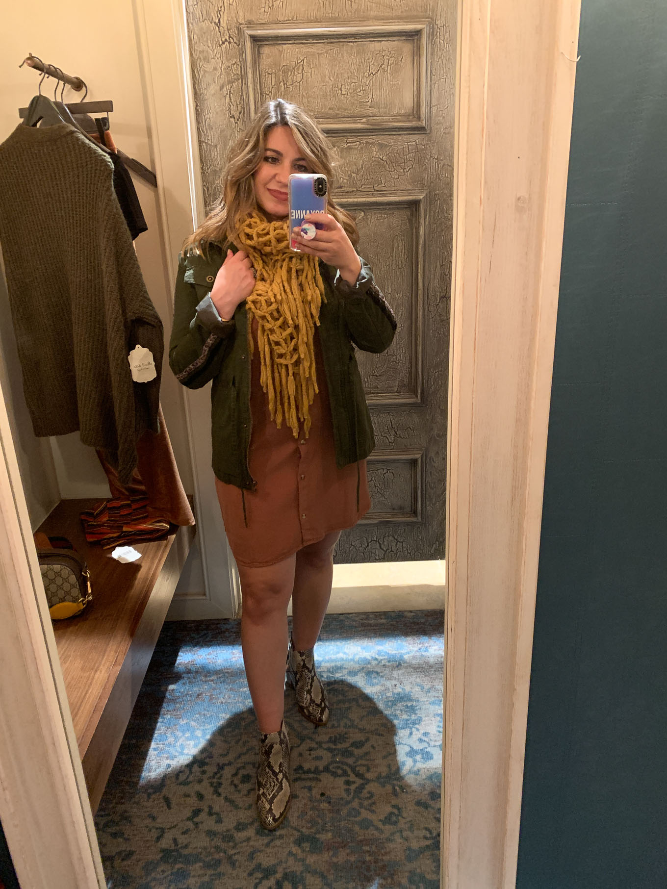 Fall Fashion at Woodfield Mall by popular Chicago fashion blog, Glass of Glam: image of a woman standing in a dressing room at Altar'd State and trying on clothes.