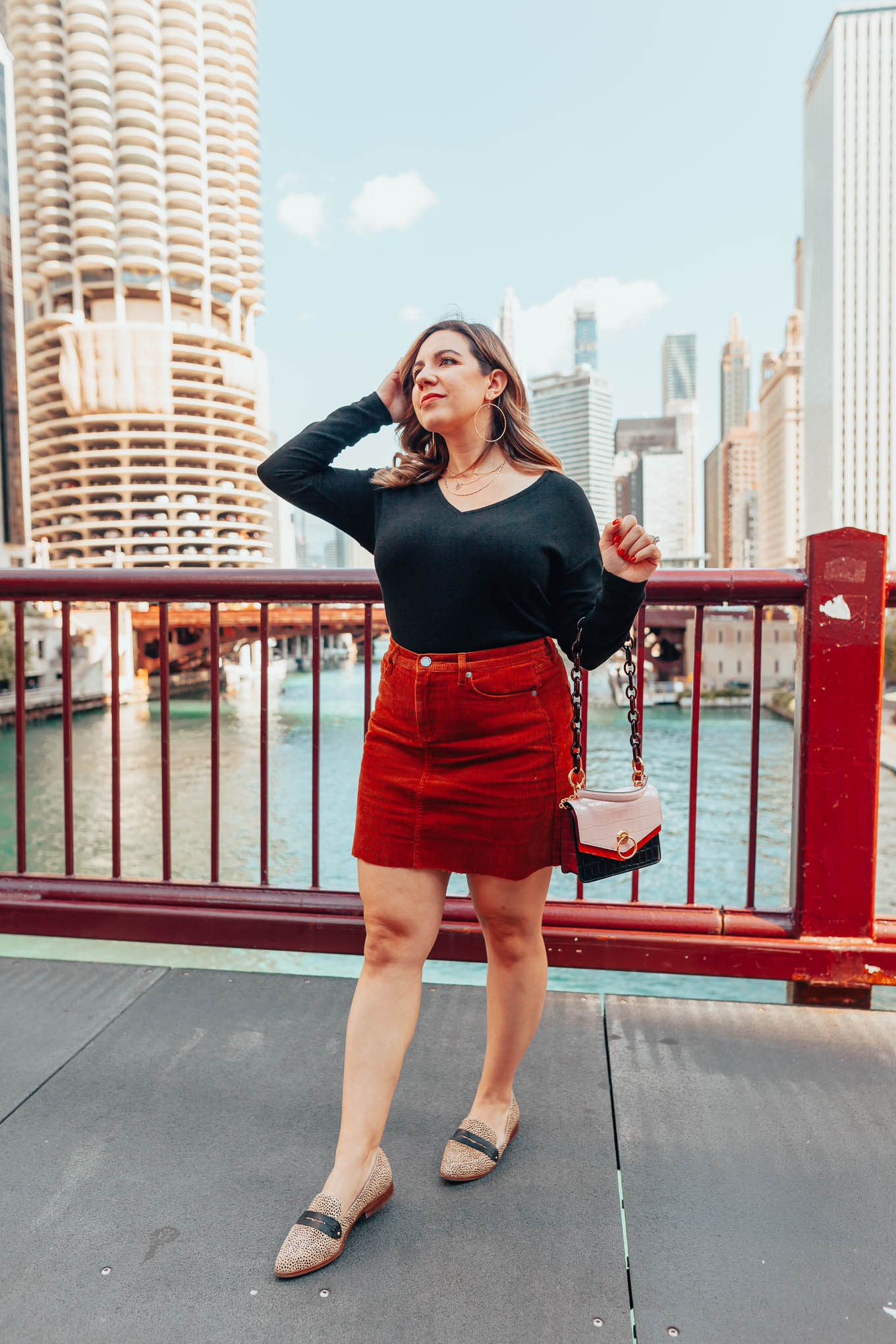 Mini Skirts for Fall Under $50 & On Mondays We Link Up by popular Chicago fashion blog, Glass of Glam: image of a woman standing outside and wearing a Nordstrom BLANKNYC Corduroy A-Line Miniskirt, Nordstrom Gibson Cozy V-Neck Top, Sole Society JESSICA SMOKING SLIPPER, and holding a Mulberry Small Harlow Satchel Red Berry Croc Print.