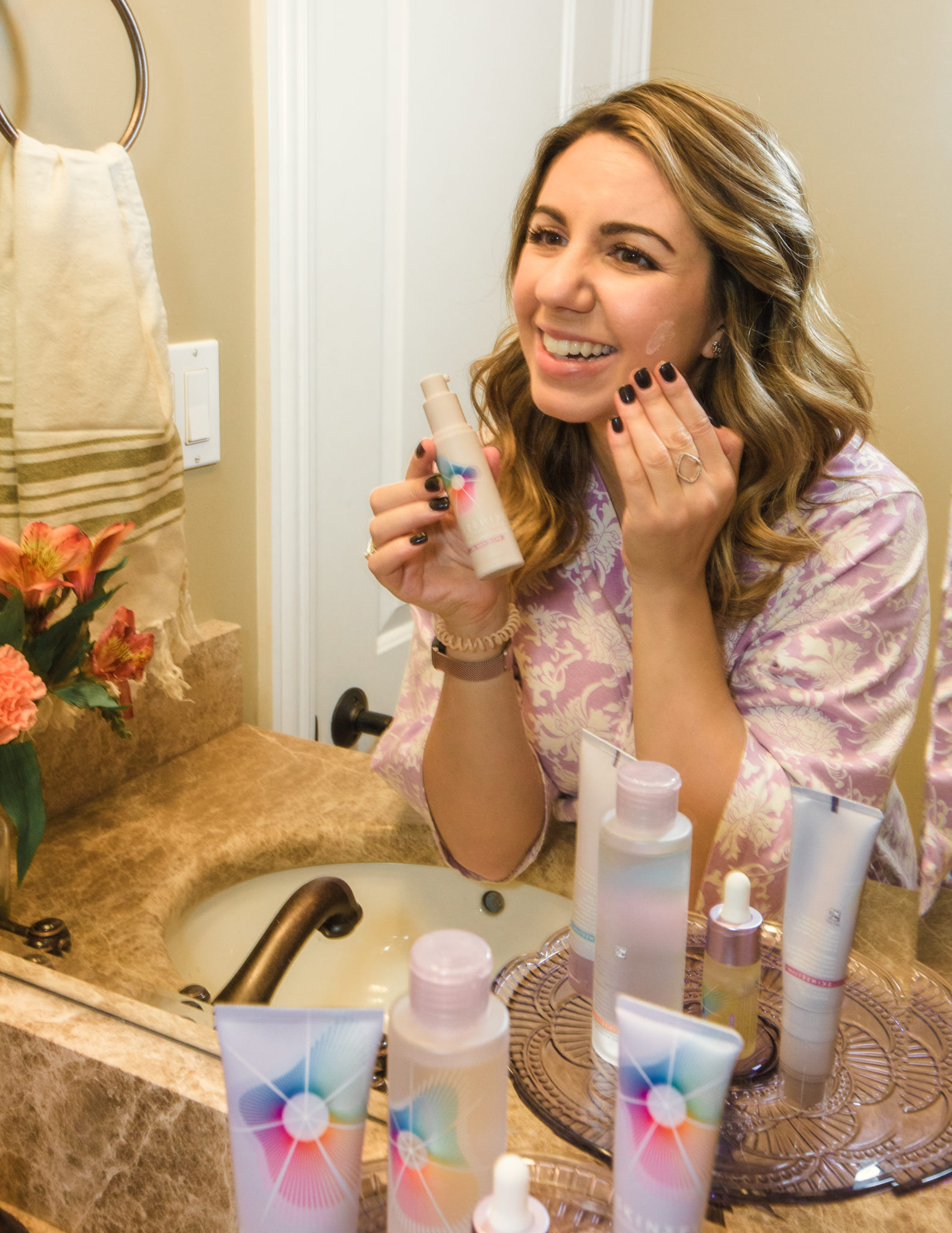 Find Your Personalized Skinsei Skincare Routine by popular Chicago beauty blog, Glass of Glam: image of a woman using Skinsei skincare products.