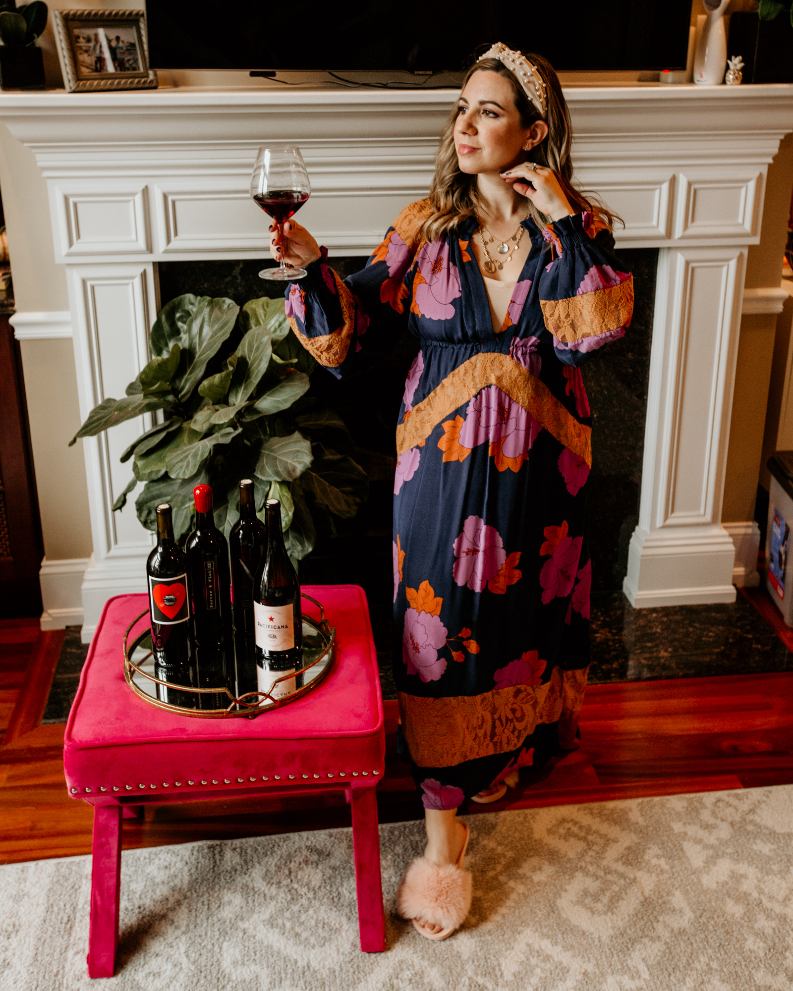 Discovering New Wines with WINC Wine Club! by popular Chicago life and style blog, Glass of Glam: image of a woman wearing an Amazon Somewhere Haute Velvet Top-knot Pearl Embellished Headband, Betani House Slippers for Women Fur Slides, and Ettika Set of 2 Disc Station Necklaces.