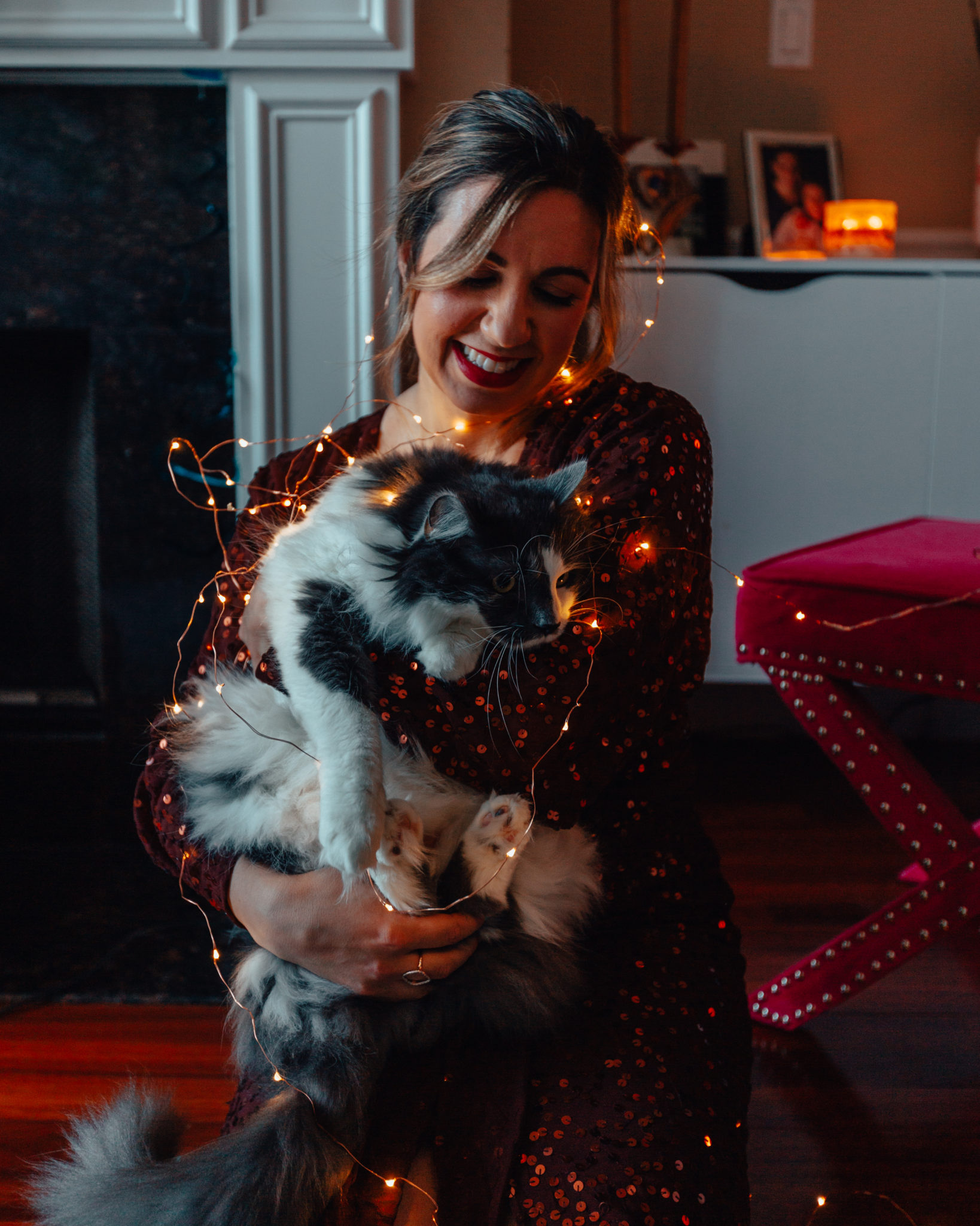 Things About Me by popular Chicago lifestyle blog, Glass of Glam: image of a woman holding a cat and wearing a Asos DESIGN midi dress with batwing sleeve and wrap waist in scatter sequin, Just Fab Karris Pump, and Ulta NYX Professional Makeup  Liquid Suede Cream Lipstick.