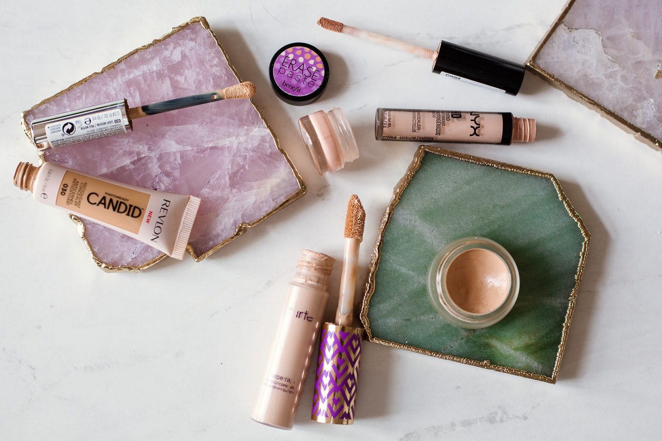 Tired Eyes? The Best Under Eye Concealers I Swear By by popular Chicago beauty blog, Glass of Glam: image of Revlon candid concealer, Tarte concealer, Benefit erase paste, rms beauty concealer, and NYX concealer.