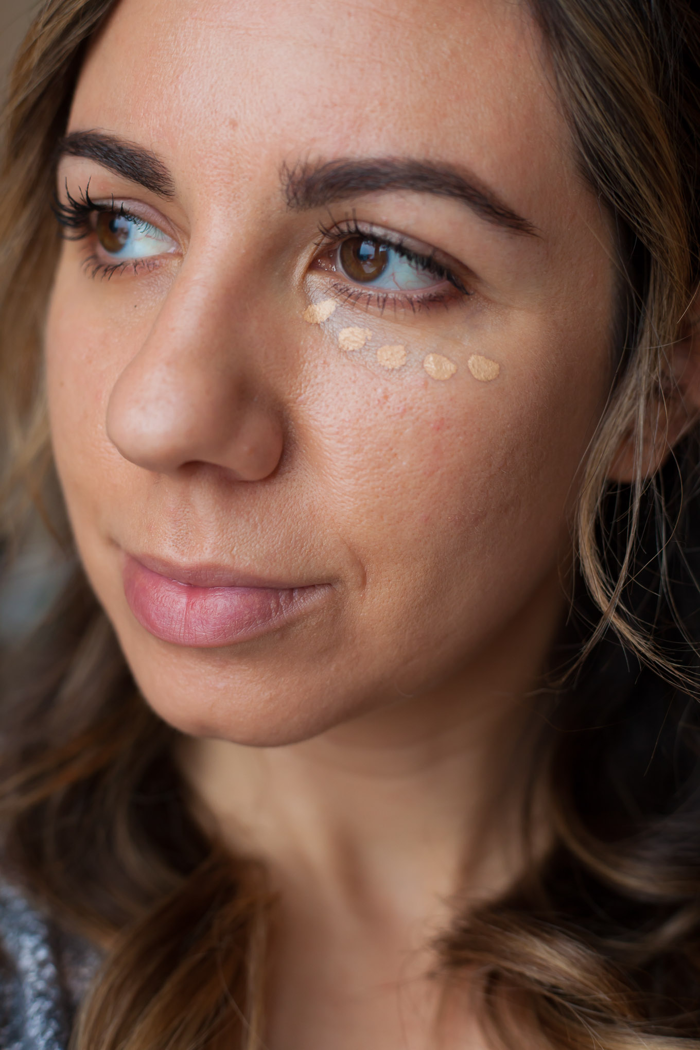 Tired Eyes? The Best Under Eye Concealers I Swear By by popular Chicago beauty blog, Glass of Glam: image of a woman wearing under eye concealer.