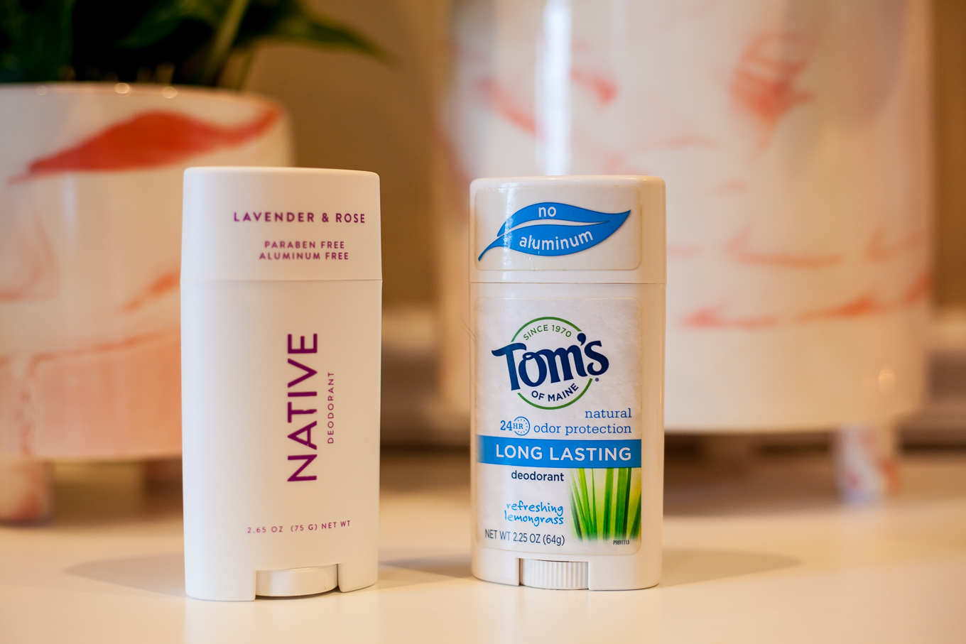 My Natural Deodorant Review by popular Chicago life and style blog, Glass of Glam: image of Native and Tom's natural deodorants.