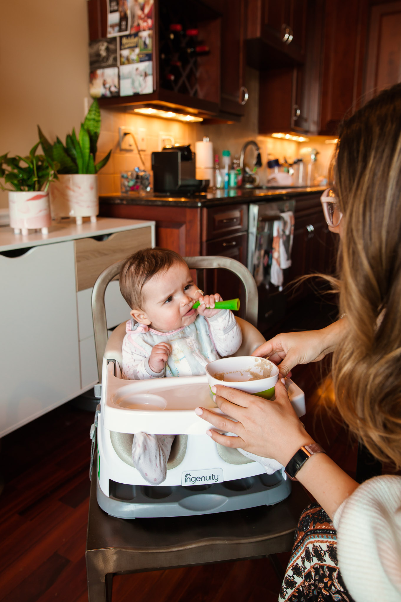 Ingenuity Baby Seat by popular Chicago mommy blog, Glass of Glam: image of a baby sitting in a Ingenuity baby seat.