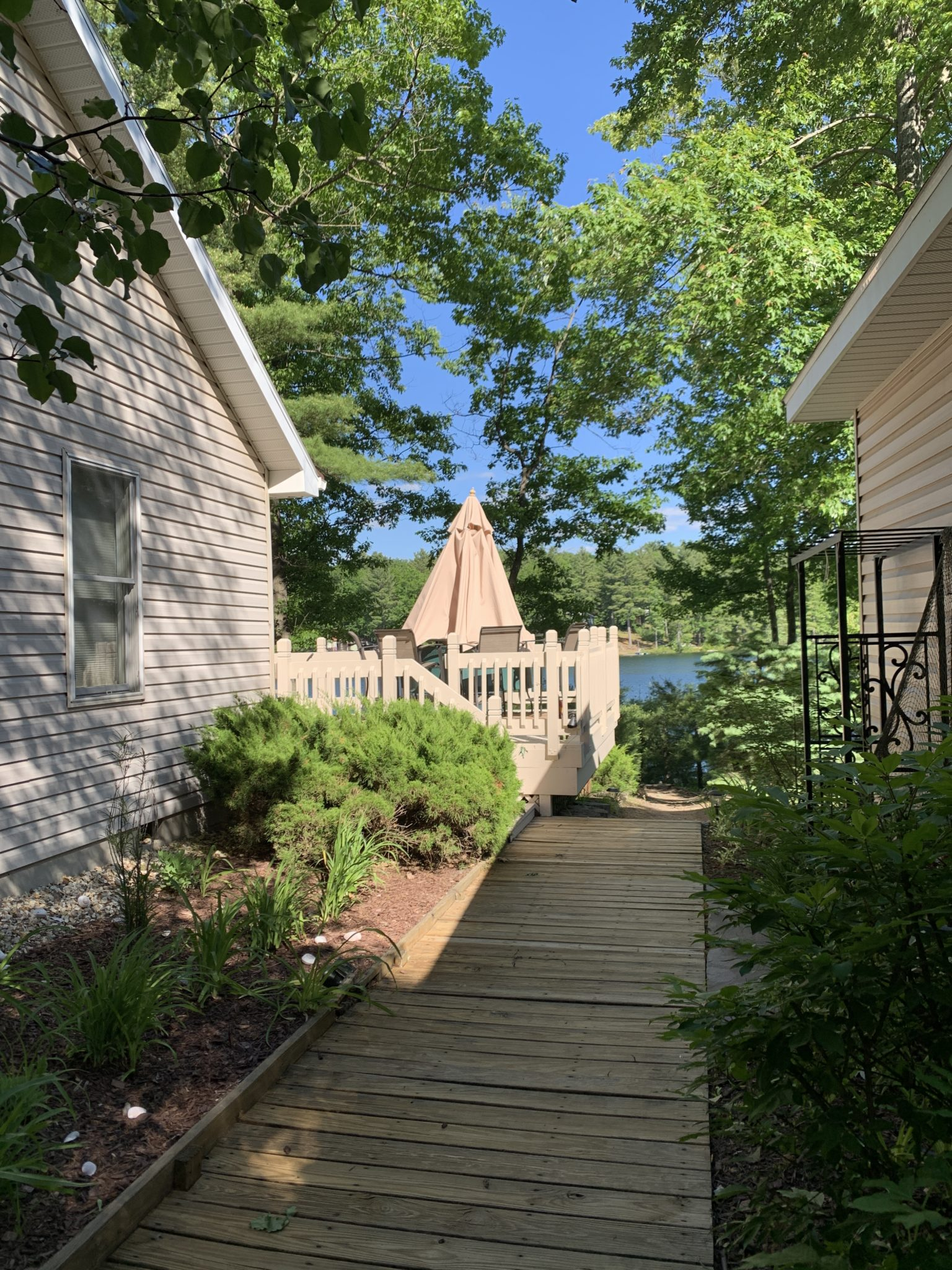 Traverse City by popular Chicago travel blog, Glass of Glam: image of a lake front cottage.