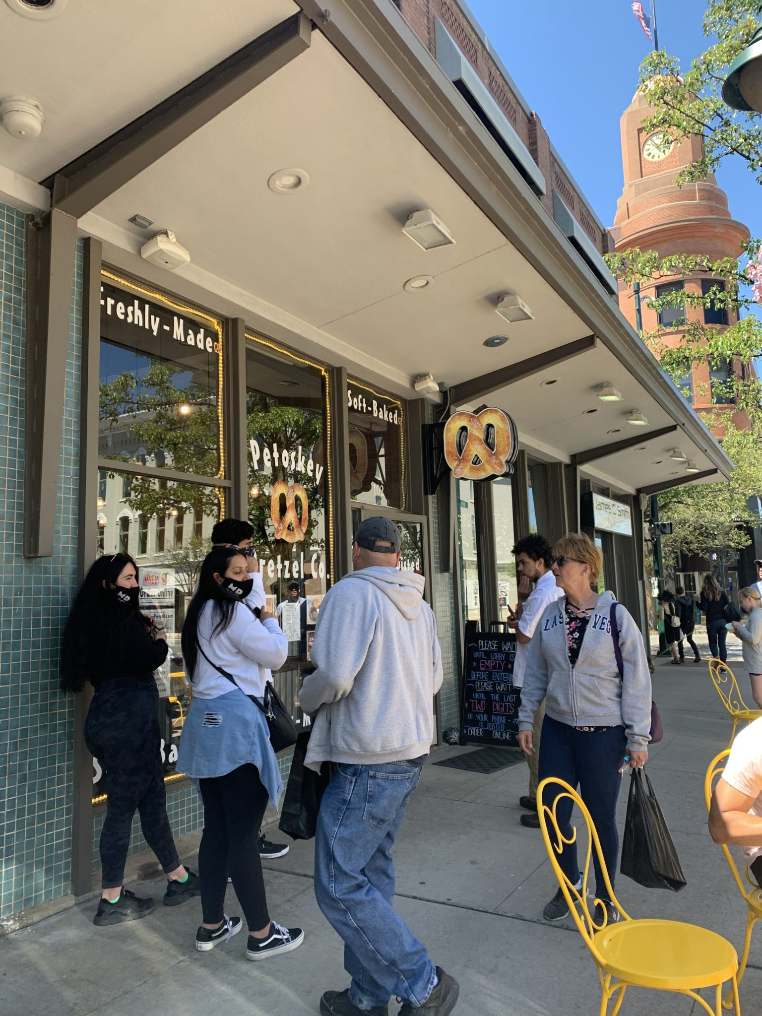 Traverse City by popular Chicago travel blog, Glass of Glam: image of a group of people standing outside a pretzel store.