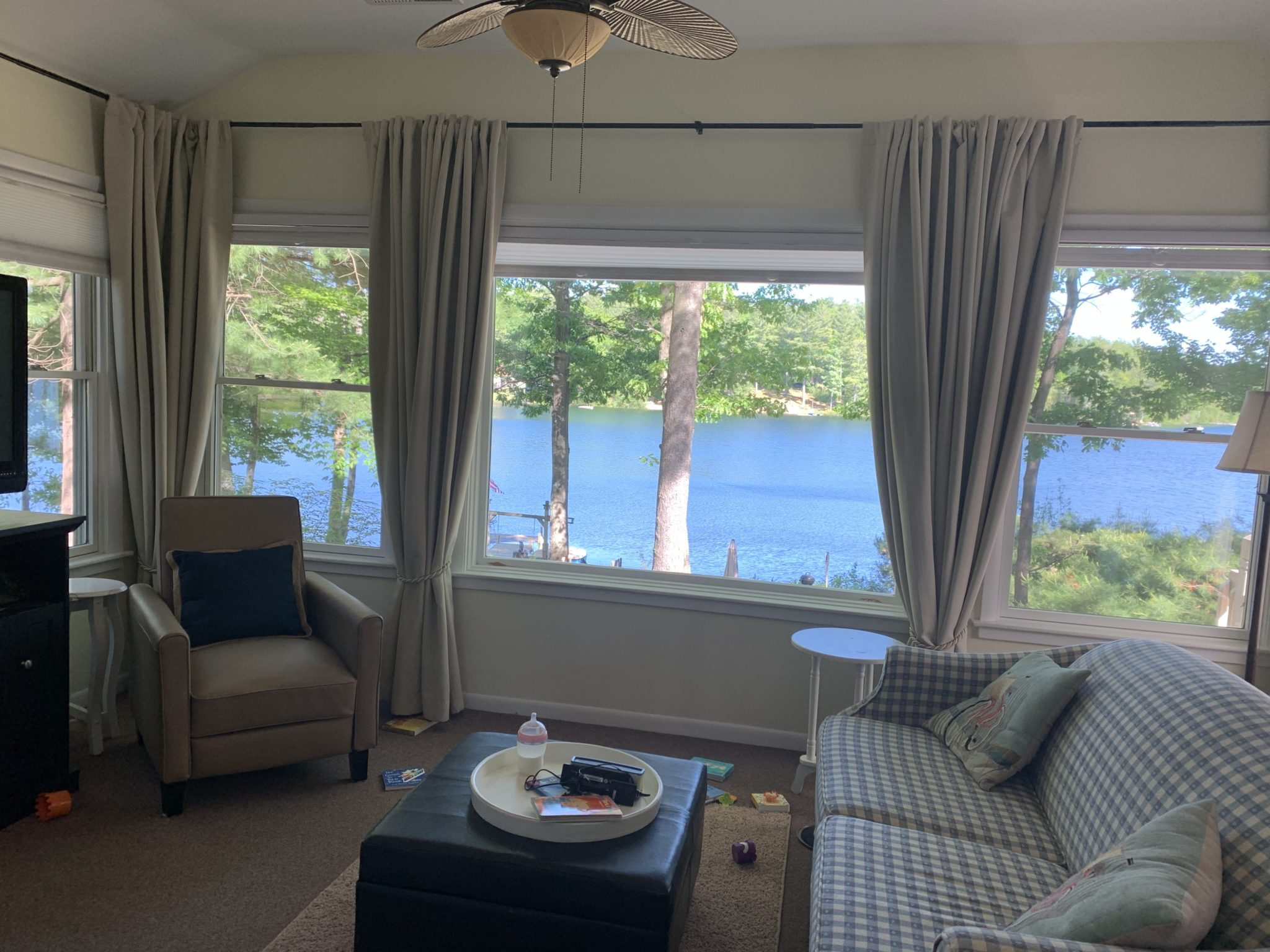 Traverse City by popular Chicago travel blog, Glass of Glam: image of a living room with a view of a lake.