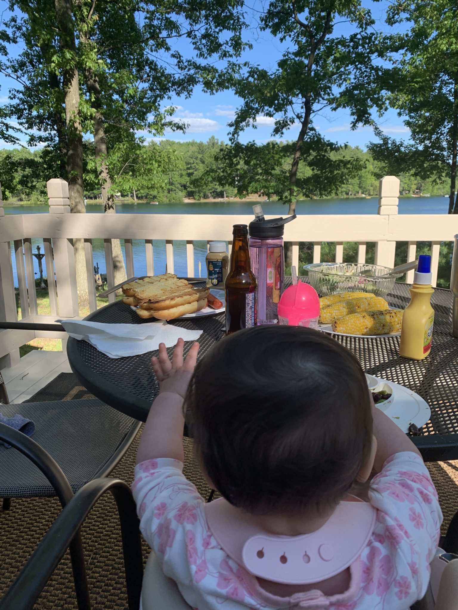 Traverse City by popular Chicago travel blog, Glass of Glam: image of a baby sitting at a table outside.
