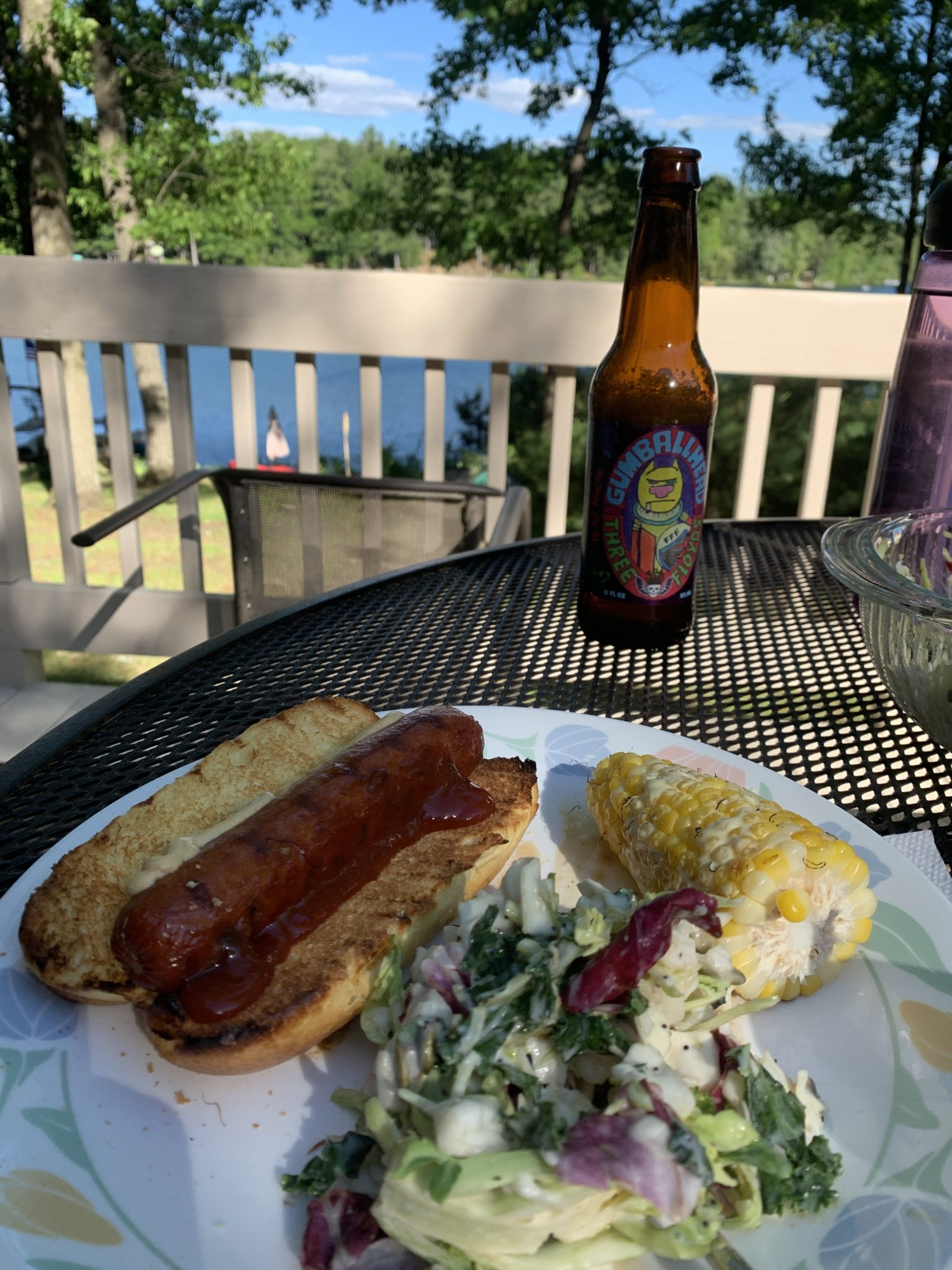 Traverse City by popular Chicago travel blog, Glass of Glam: image of a hot dog, salad, and corn on the cob.