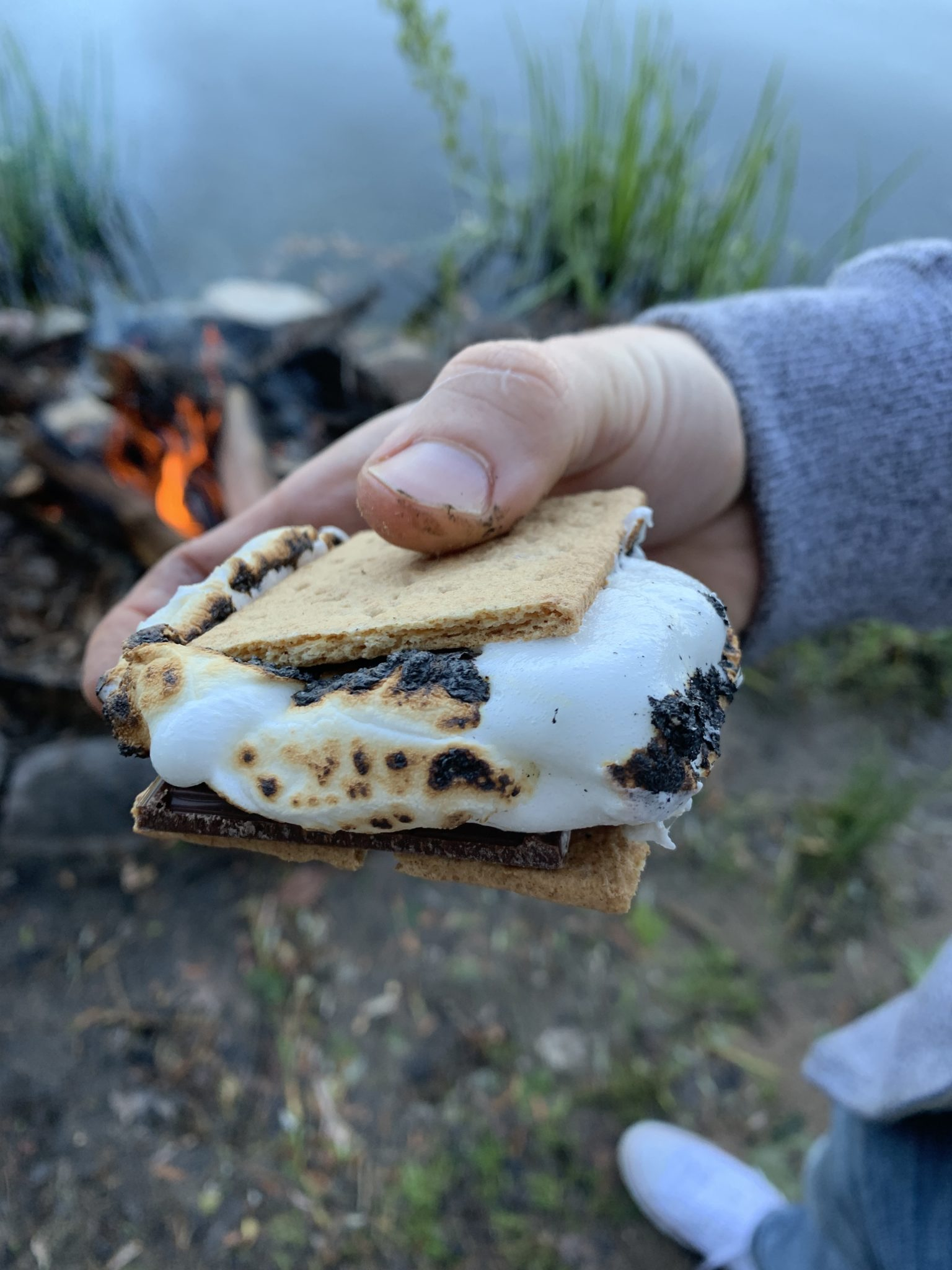 Traverse City by popular Chicago travel blog, Glass of Glam: image of a woman holding a s'more.