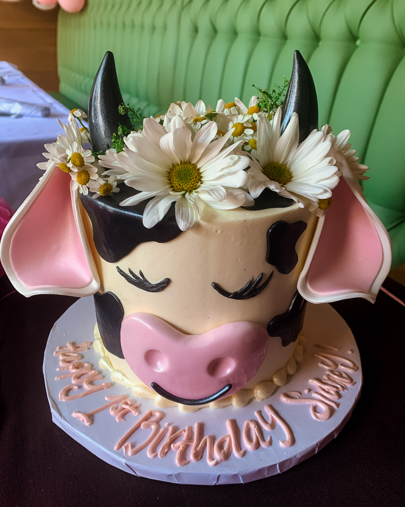 1st Birthday by popular Chicago lifestyle blog, Glass of Glam: image of a ECBG cake studio cow cake.