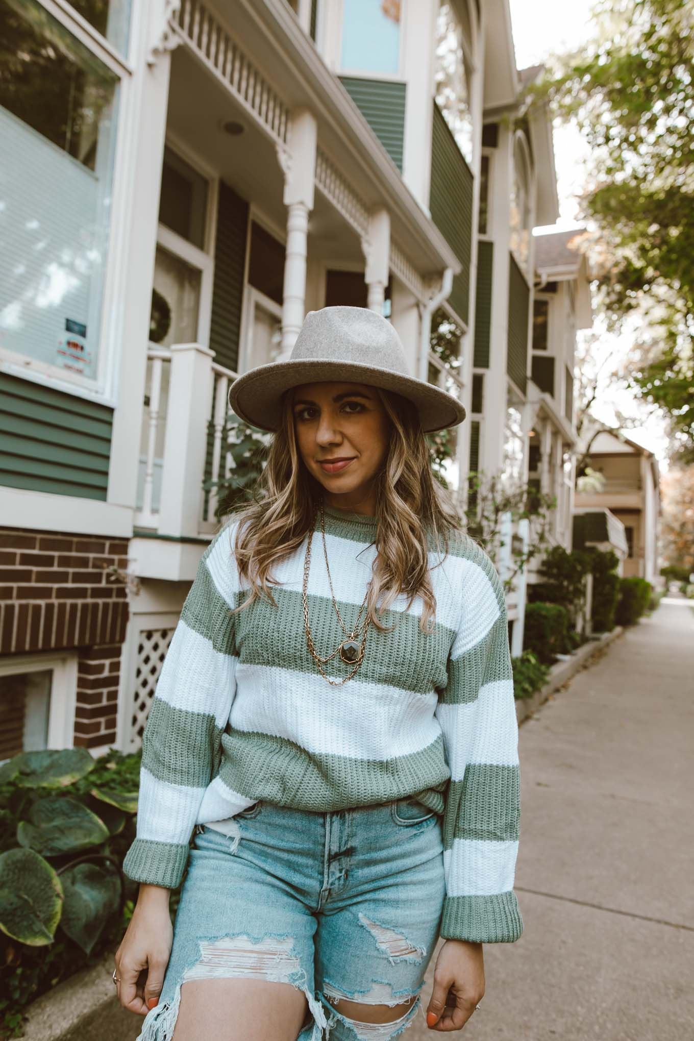 Fall Hat by popular Chicago fashion blog, Glass of Glam: image of a woman outside wearing a Amazon ZESICA Women's Long Sleeve Crew Neck Striped Color Block Comfy Loose Oversized Knitted Pullover Sweater, American Eagle Mom Jean, Nordstrom Vans sneakers, Amazon Lisianthus Women Belt Buckle Wool Wide Brim Fedora Hat, and Kendra Scott Davis Vintage Gold Multi Strand Necklace In Golden Obsidian.