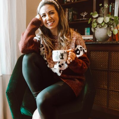 Pearl Headband by popular Chicago fashion blog, Glass of Glam: image of a woman sitting in a green velvet chair and wearing a Pink Lily Fascinating Stories Animal Print Burgundy Sweater, Nordstrom Spanx faux leather leggings, and Amazon Pearl Velvet Headband.