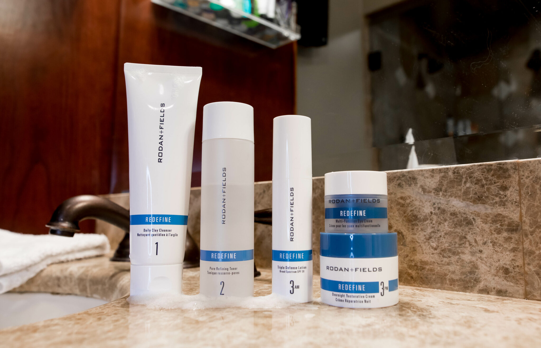 Rodan and Fields Redefine Regimen by popular Chicago beauty blog, Glass of Glam: image of the Rodan and Fields Redefine regimen products.