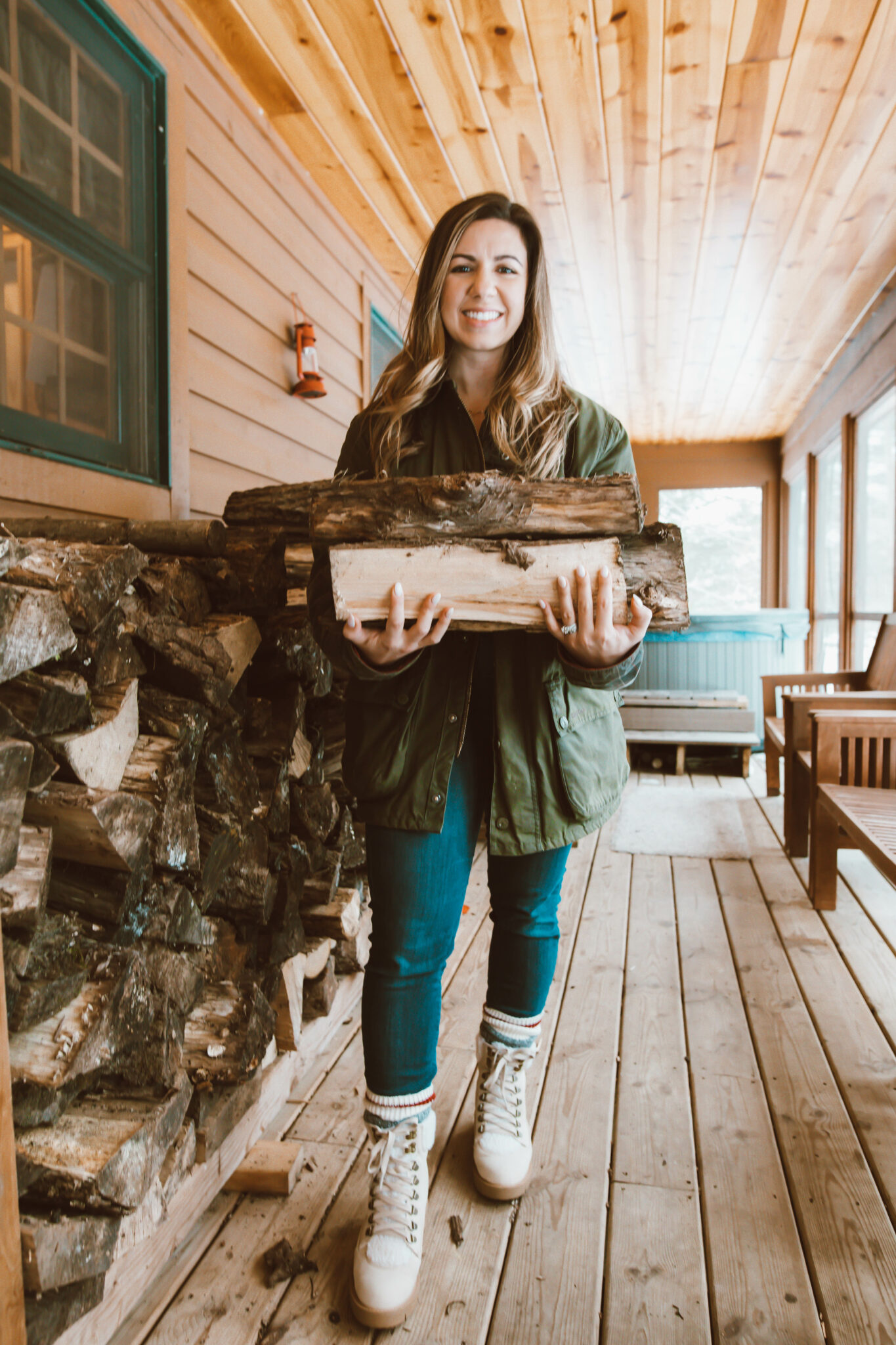 Olive Clothing by popular Chicago fashion blog, Glass of Glam: image of a woman standing on a cabin deck and wearing a waffle henley, Agolde denim, Just Fab boots, socks, Dan's Barbour Jacket