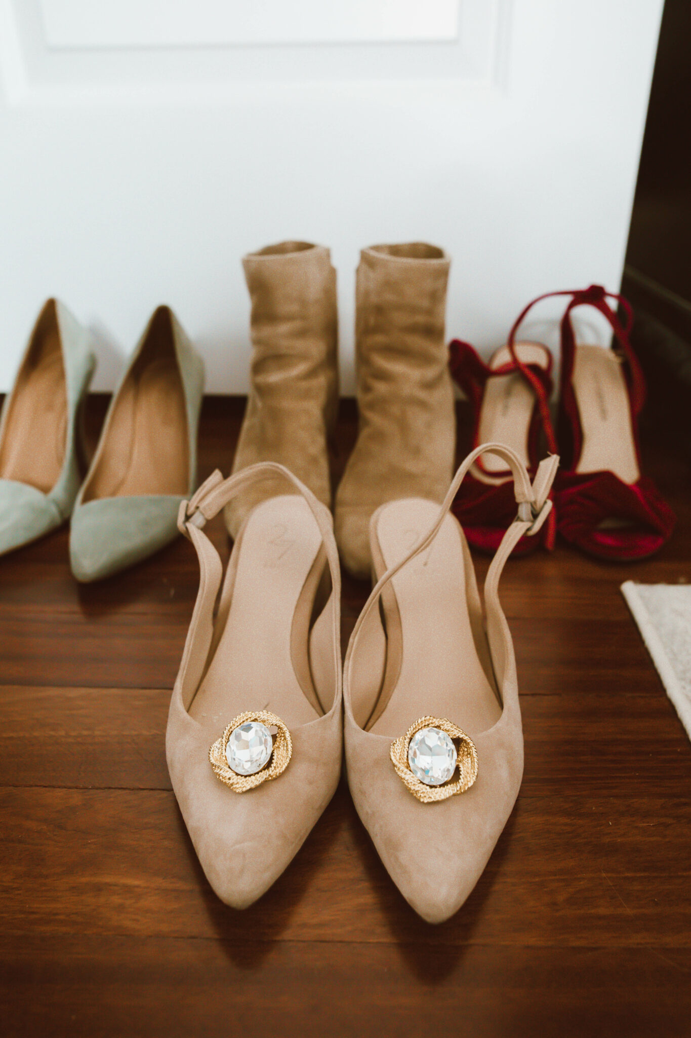 Clip On Earrings by popular Chicago fashion blog, Glass of Glam: image of brown suede pumps with clip on earrings on them.