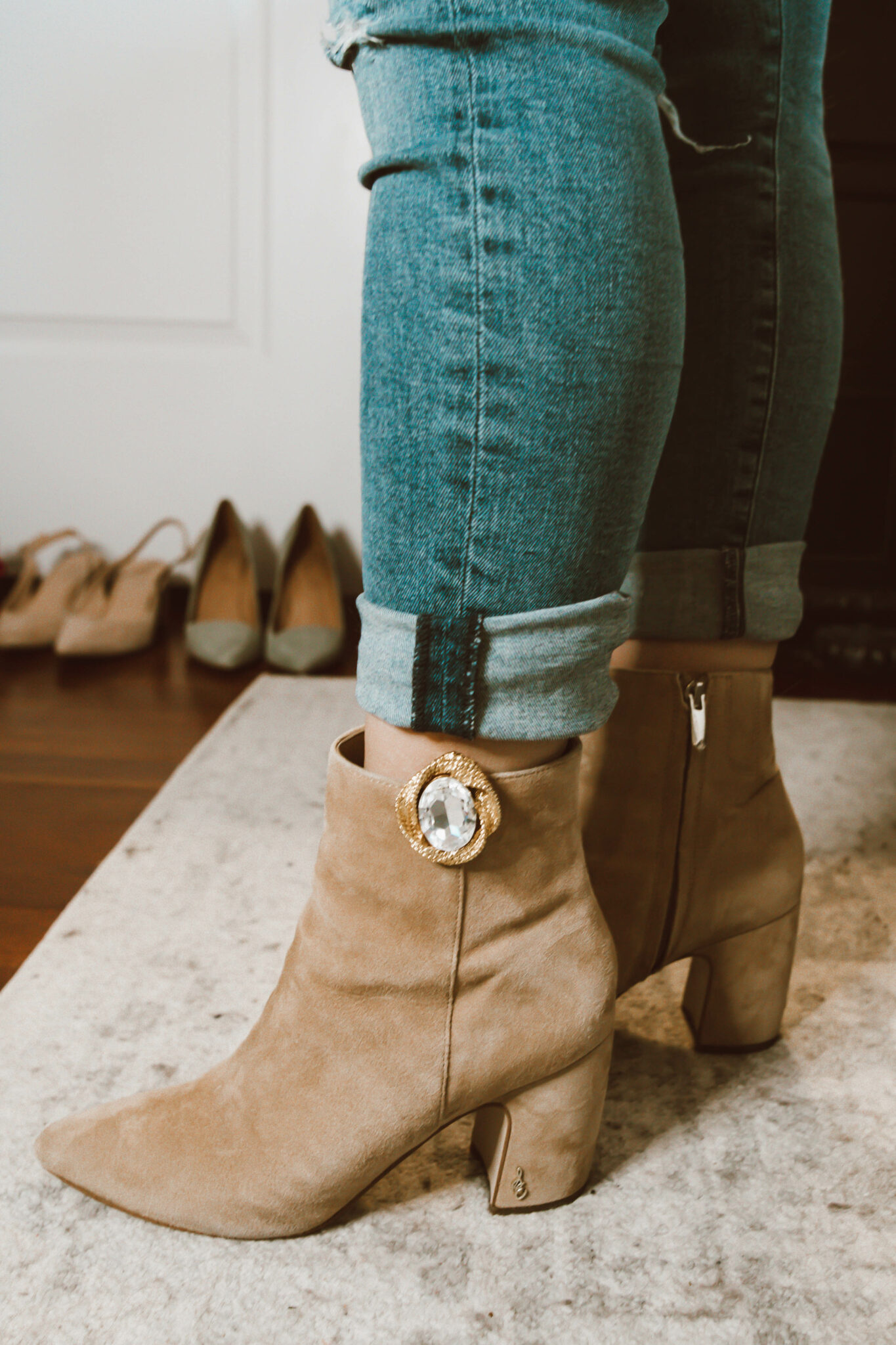 Clip On Earrings by popular Chicago fashion blog, Glass of Glam: image of a woman wearing brown suede ankle boots with clip on earrings attached to them.