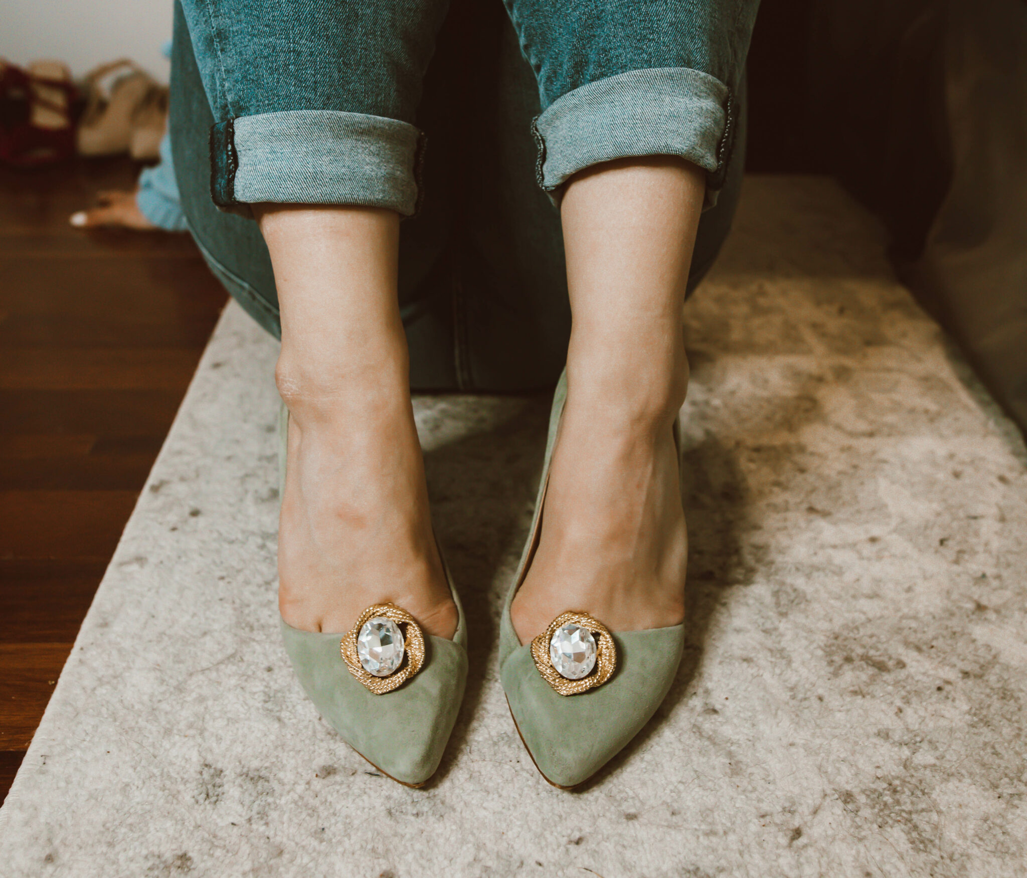 Clip On Earrings by popular Chicago fashion blog, Glass of Glam: image of a woman wearing green suede pumps with clip on earrings attached to them.