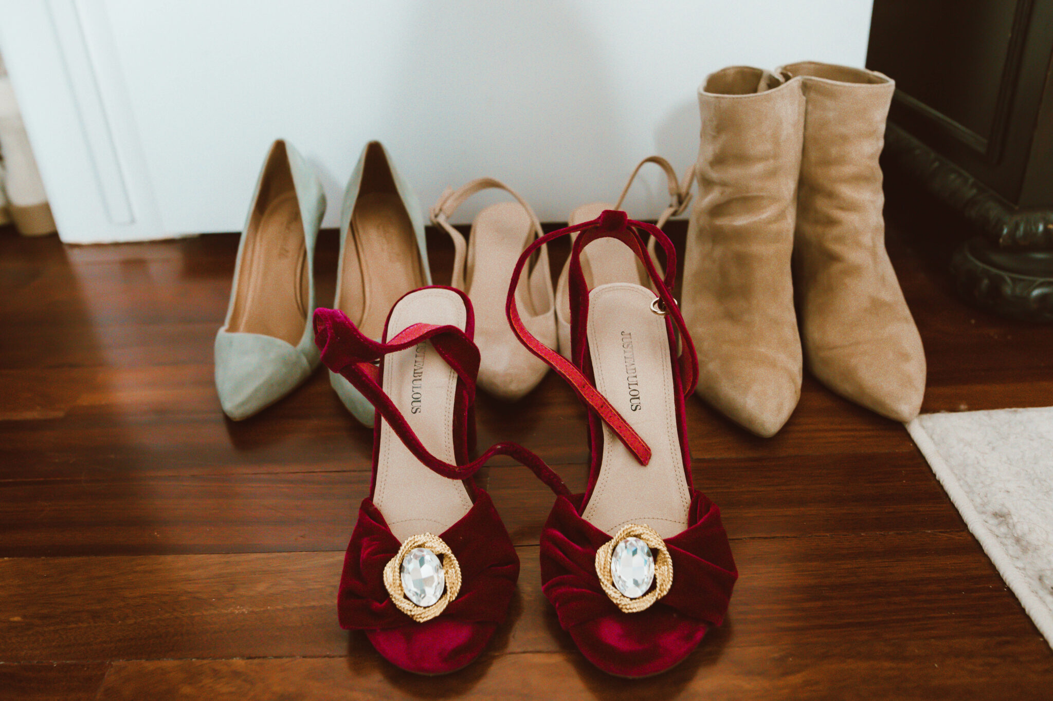 Clip On Earrings by popular Chicago fashion blog, Glass of Glam: image of brown suede ankle boots, red velvet strappy pumps, green suede heels, and brown suede sling back heels.