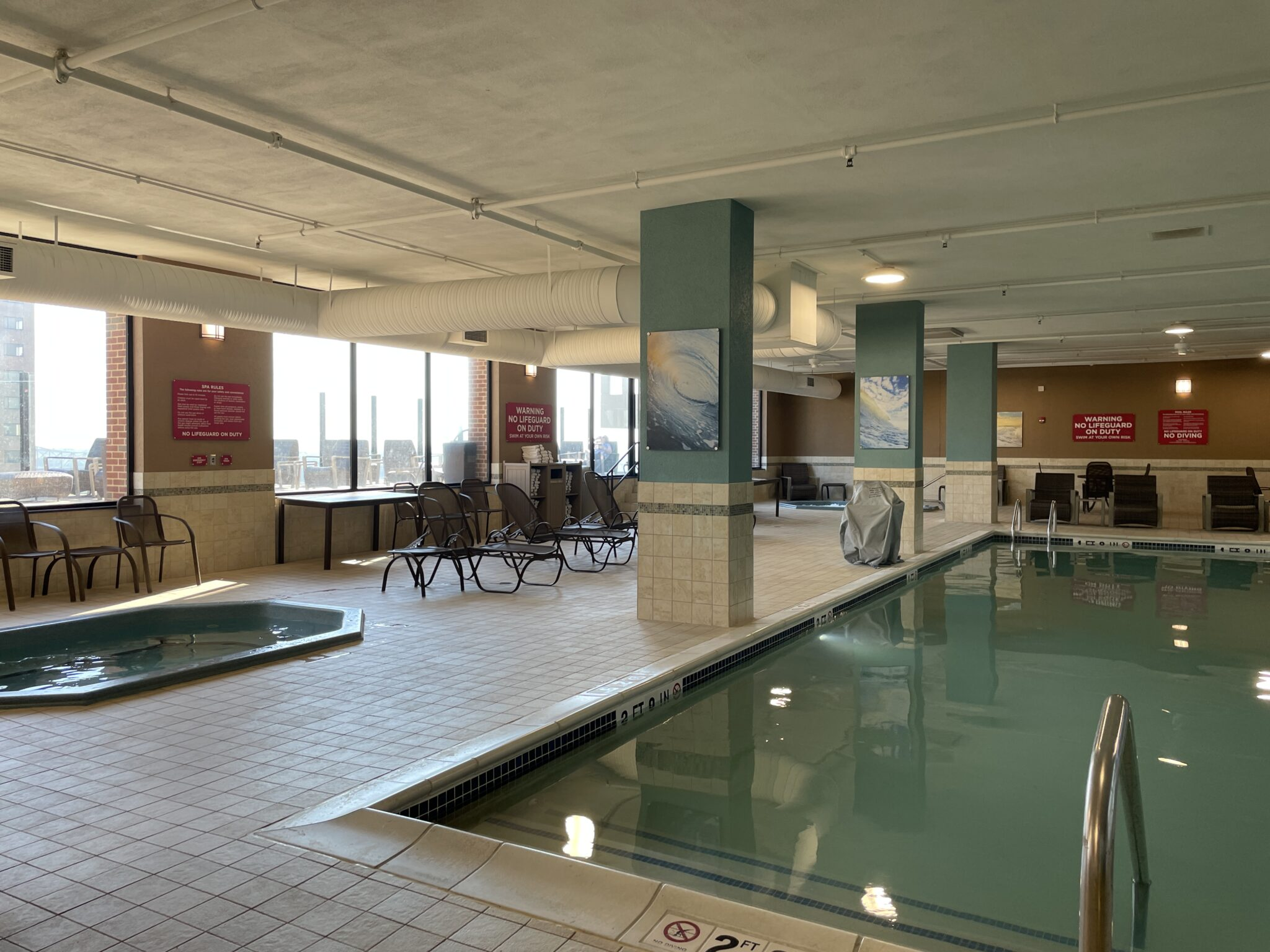 Traveling to St. Louis by popular Chicago travel blogger, Glass of Glam: image of an indoor swimming pool and hot tub.