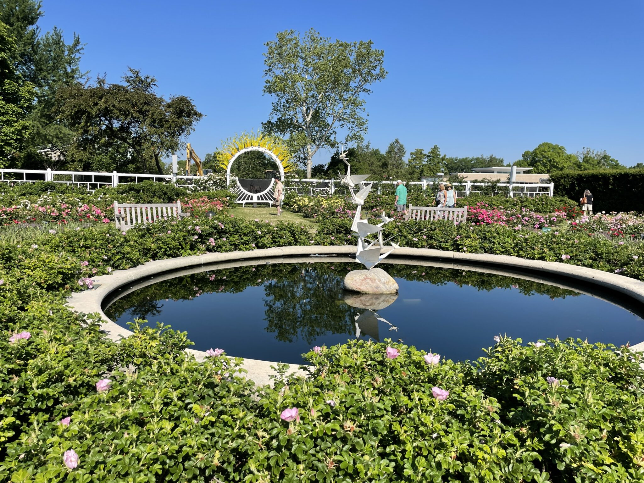 Traveling to St. Louis by popular Chicago travel blogger, Glass of Glam: image of a fountain in a flower garden.