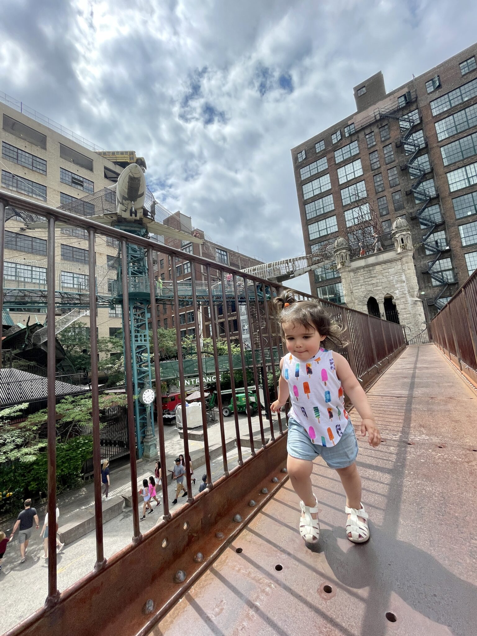 Traveling to St. Louis by popular Chicago travel blogger, Glass of Glam: image of a little girl walking on a bridge.