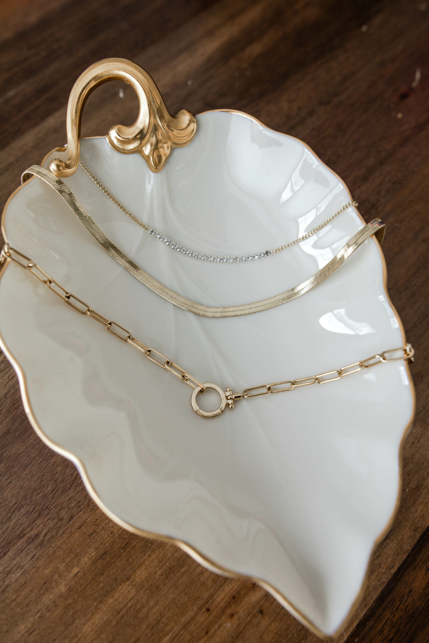 Gorjana Stacking Necklaces by popular Chicago fashion blog, Glass of Glam: image of Gorjana Stacking Necklaces in a white porcelain dish.