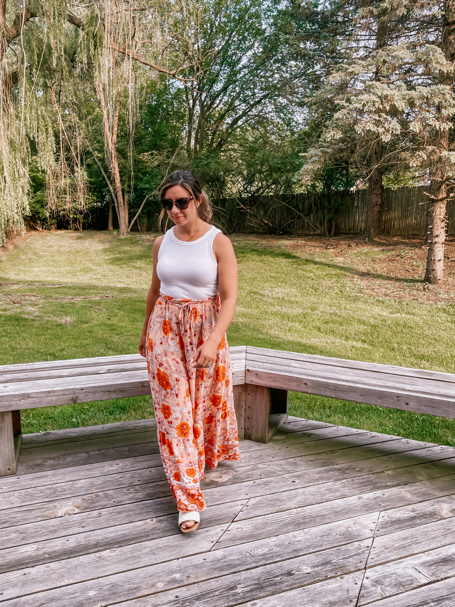 Summer Maxi Skirt by popular Chicago fashion blog, Glass of Glam: image of a woman standing outside and wearing a white tank top, sunglasses, white sandals, and orange and pink floral maxi skirt.